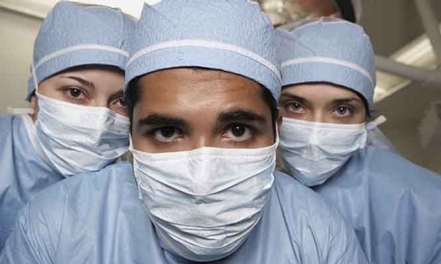 photo of three surgeons